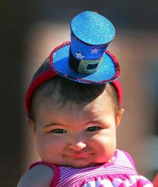 Sarah Elizabeth Major, 8 months old, wore a patriotic hat as she watched the parade go down Court Street in Plymouth.